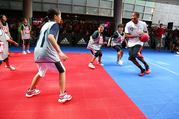 Derrick Rose of the Chicago Bulls plays against a group of Japanese fans at the 1 on 100 event.