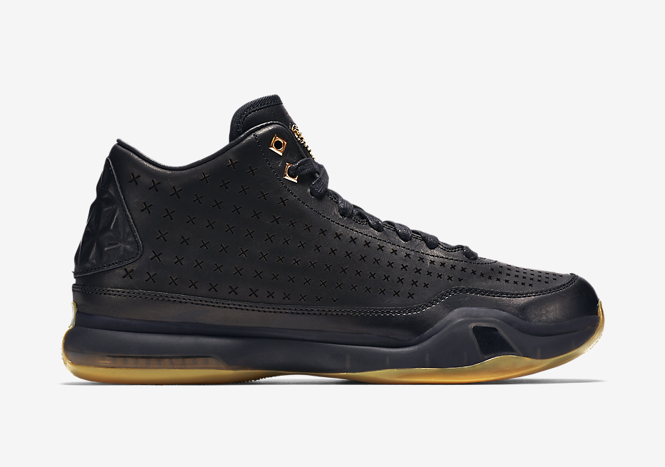 63457b8276a1 The gold Kobe logo on the tongue matches the gum rubber outsole below. Look  for this pair to drop soon at Nike Basketball retailers. Nike Kobe 10 Mid  EXT   ...