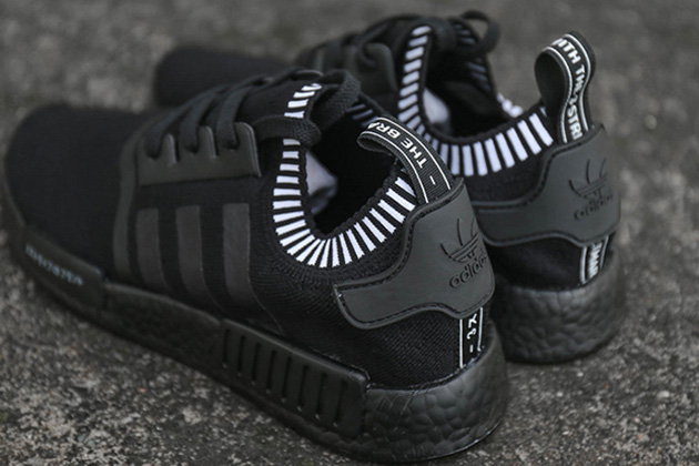 boost finally goes black on the nmd r1 39 triple black. Black Bedroom Furniture Sets. Home Design Ideas