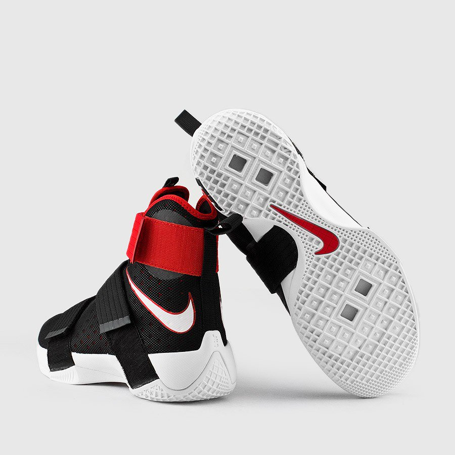 The Nike LeBron Soldier 10 in Black/ University Red is ...