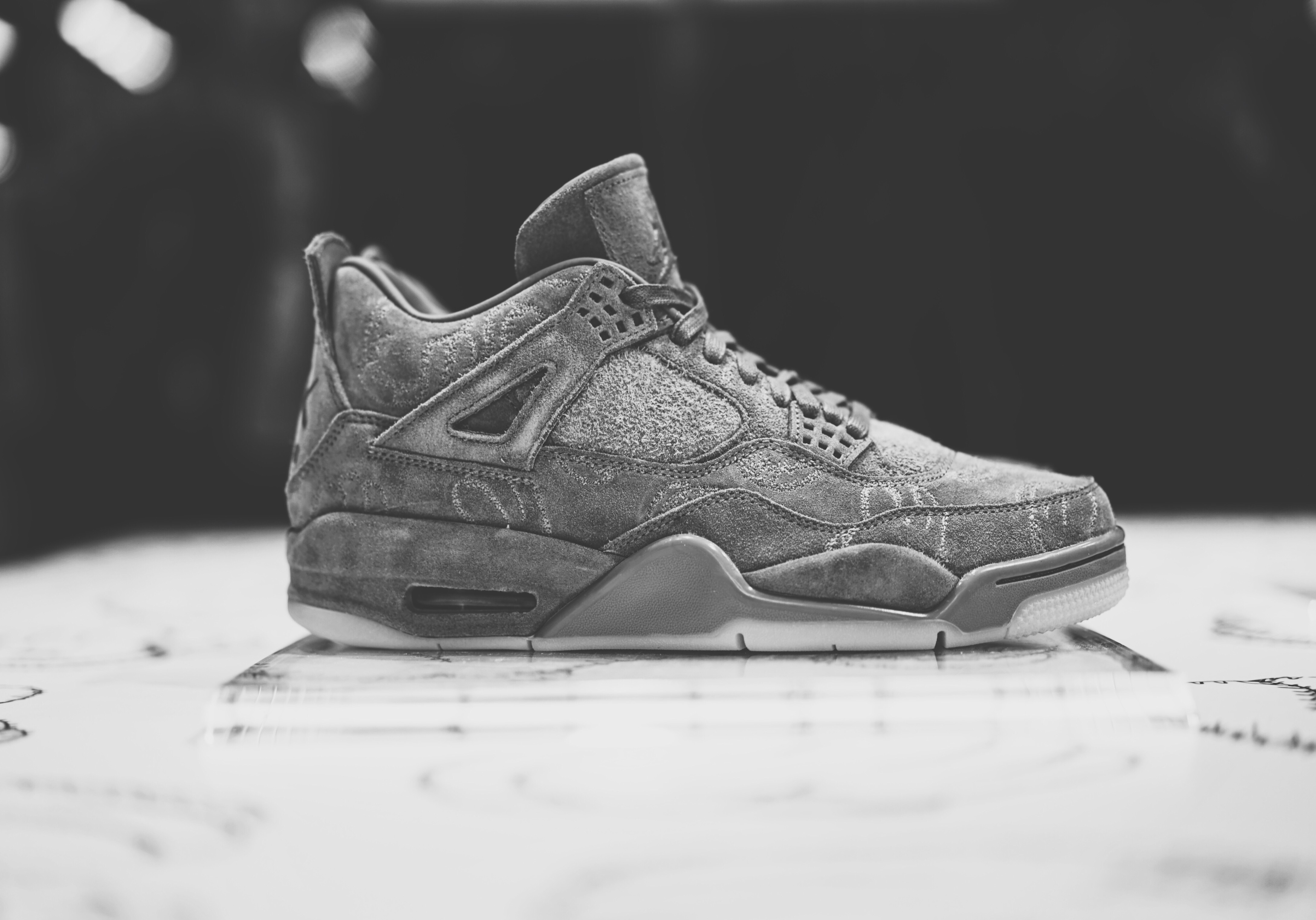 reputable site a1d85 7b200 The Kaws x Air Jordan 4 Will Release Online - WearTesters