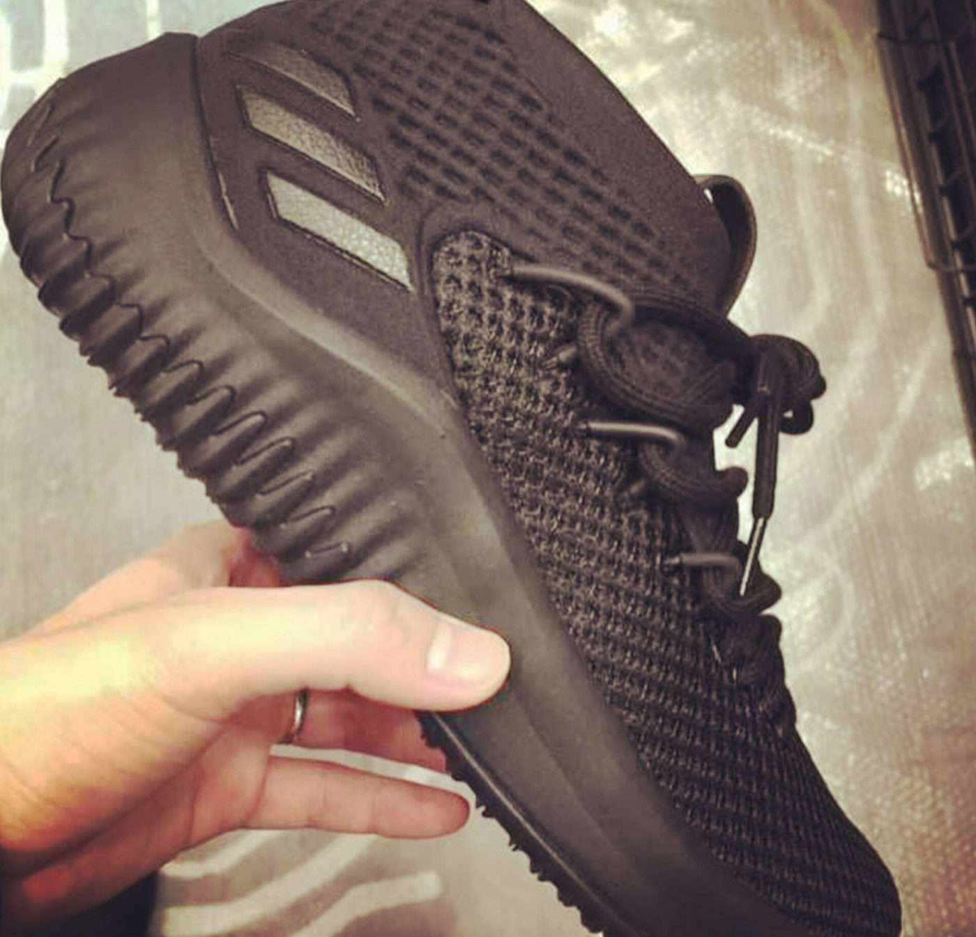 The Triple Black adidas Dame 4 is