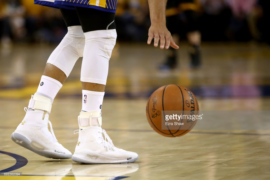 Stephen Curry makes fan switch into his shoes after fan hits half court