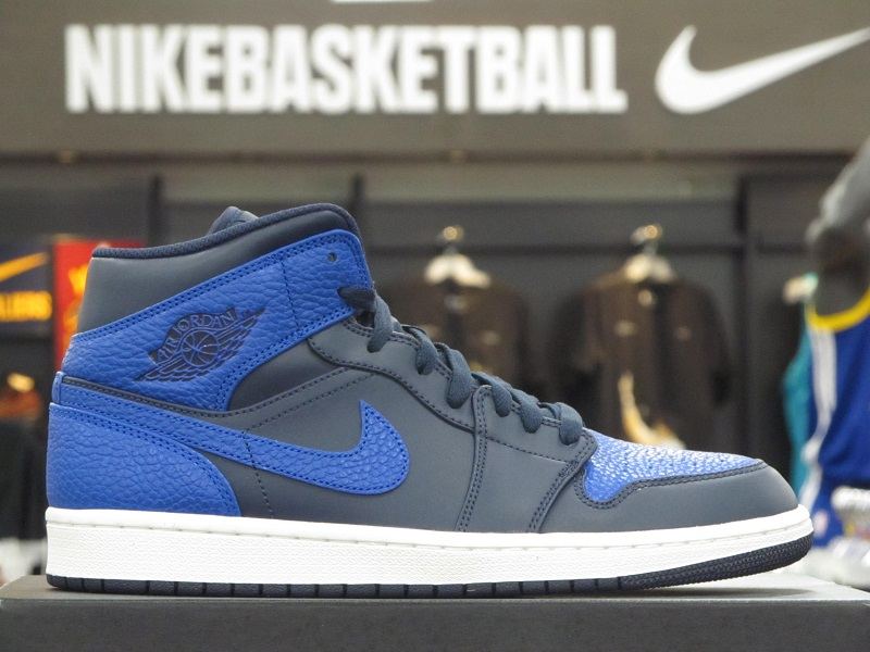 The Air Jordan 1 Mid Obsidian Mimics The Royal Look In Shades
